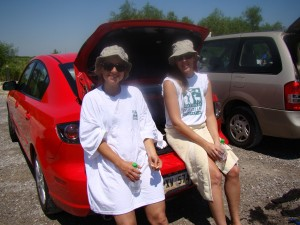 Staff members Ali Sickle and Becki Chall relax after a hard day's work in the marsh.