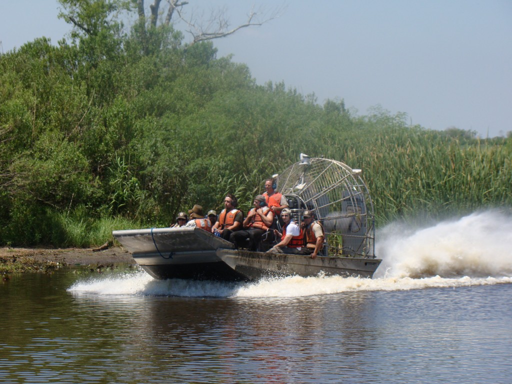 The Global Green New Orleans staff rides an airboat out to Bayou Sauvage