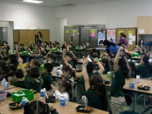 green_school_hands_up