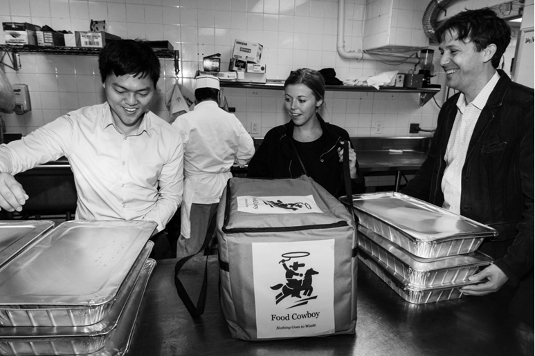 Robert Lee, Colleen Large and Matt de la Houssaye pick up food from Cipriani 42nd.