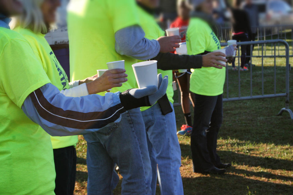 Volunteers handing out cups.