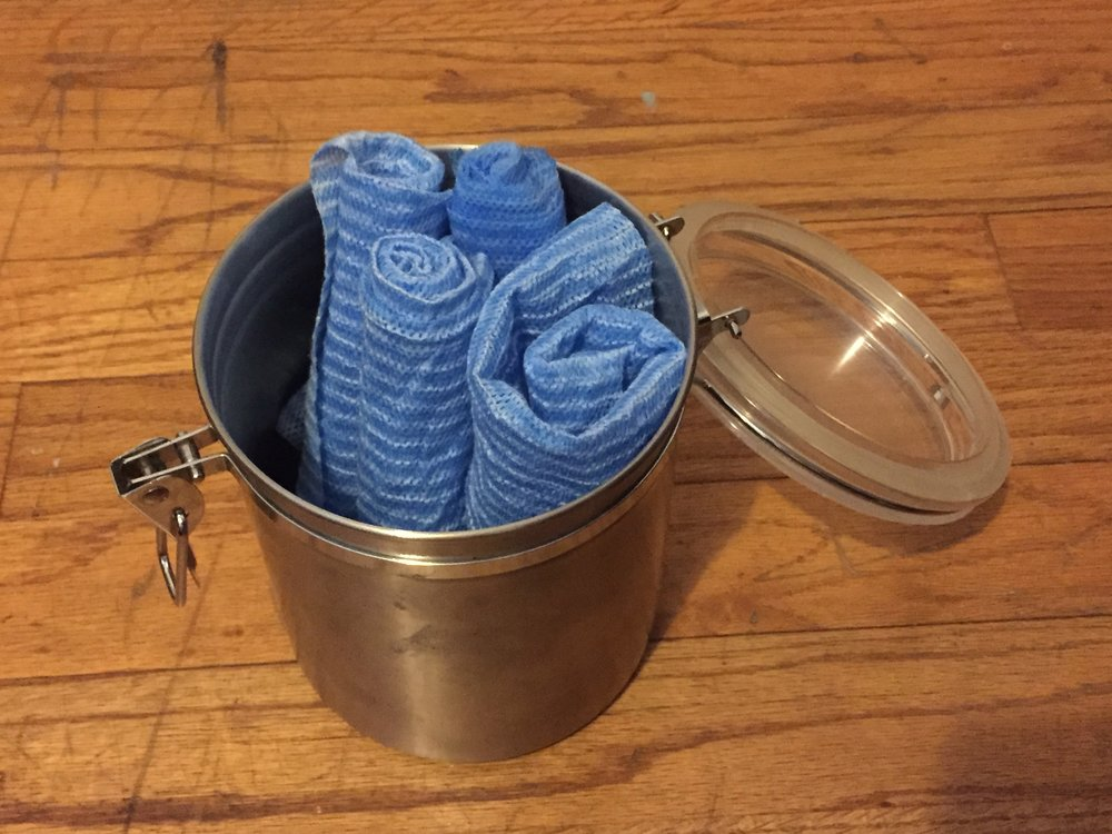 DIY dryer sheets in reusable container.