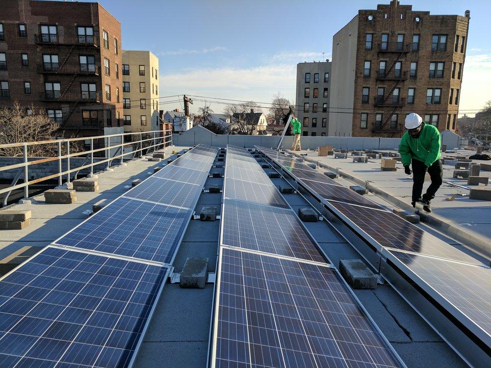 Global Green .Solar Installation at Church of God Christian Academy, New York (Solar for Sandy).