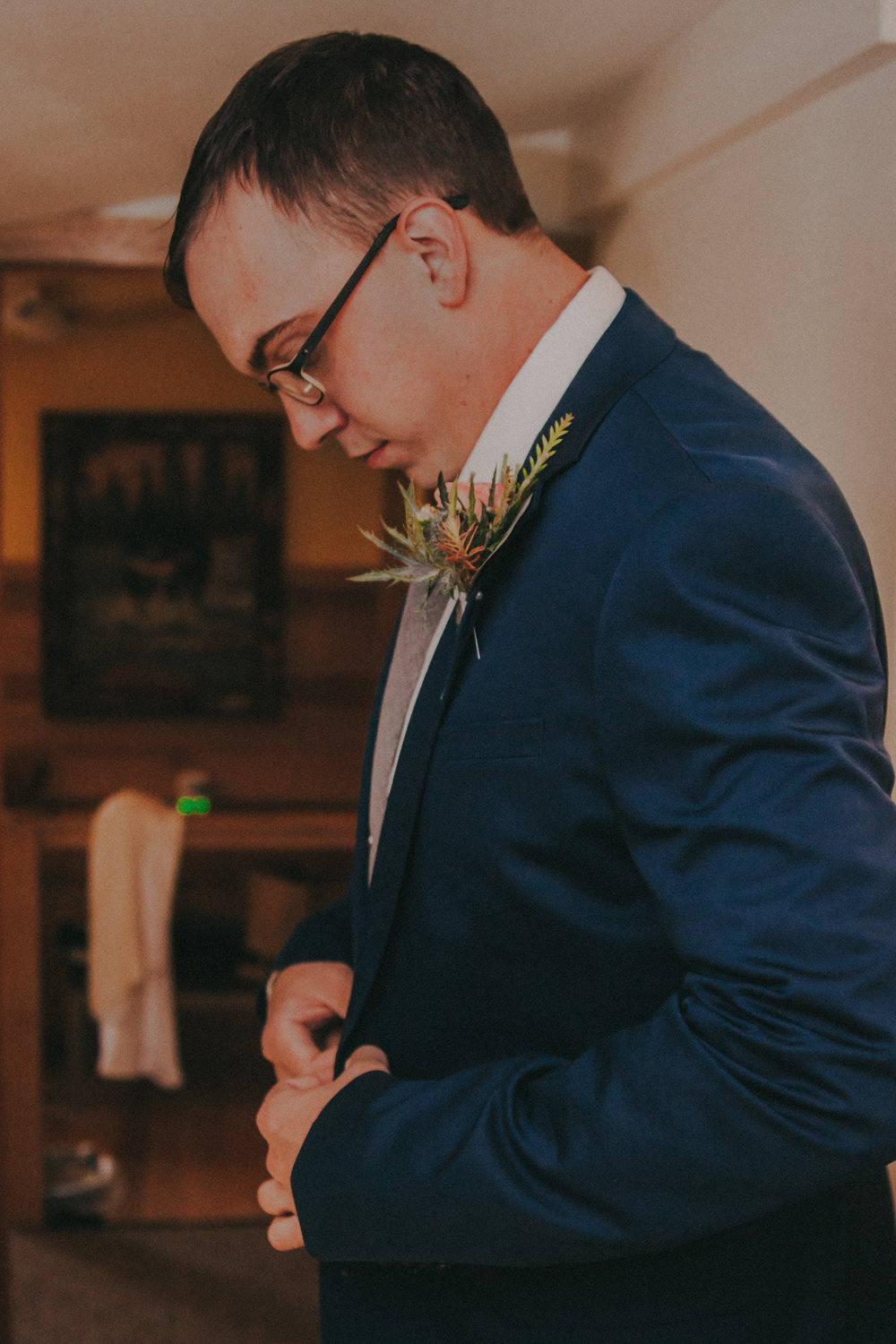 "My groom was my ""something blue"". While the rest of our groomsmen wore grey, Kyle wore a navy blue suit. We were a little worried how everything would look when put together, but it worked out in the end and made him stand out."