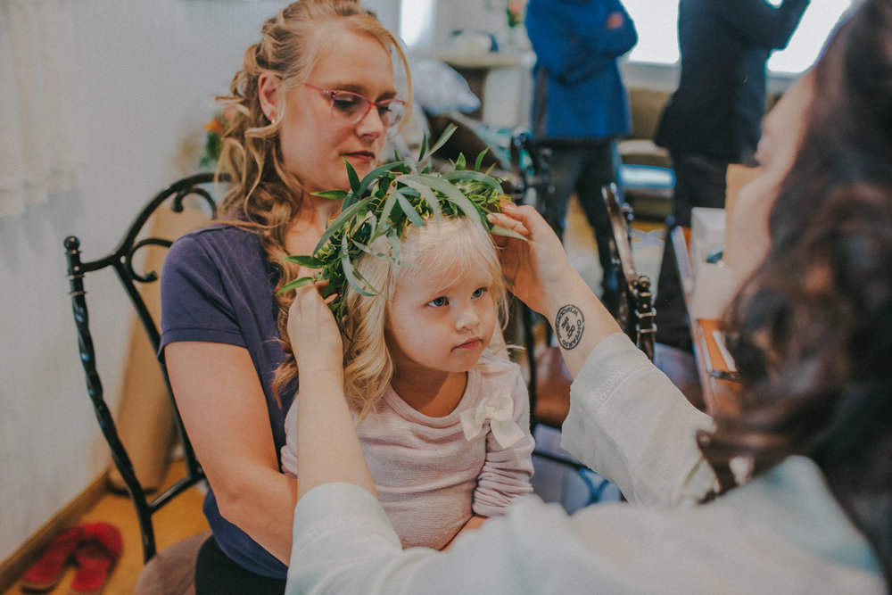 Our flower girls wore olive branch crowns. The olive branch is meant to symbolize peace and the joining of two parties that were once separated. They were the extra pinch of good luck over our wedding.