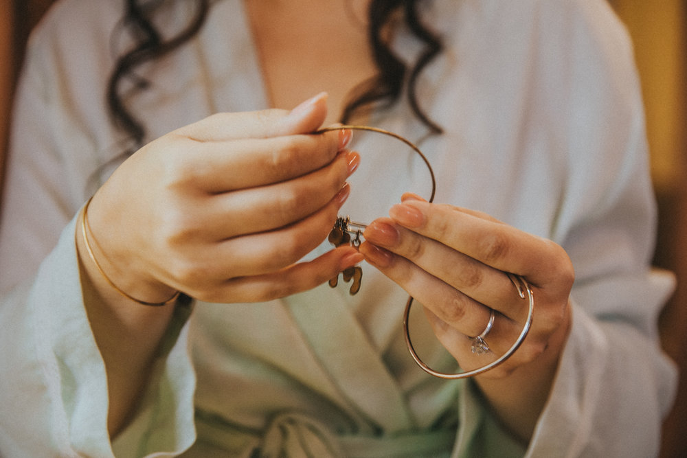 """I wore a lobster Alex and Ani bracelet that Kyle had bought for me. For those who don't get the F.R.I.E.N.D.S reference; Lobsters choose one mate for life. So I'm his Lobster.  The other bracelet I wore was a golden knot. """"Tying the Knot""""…get it?"""