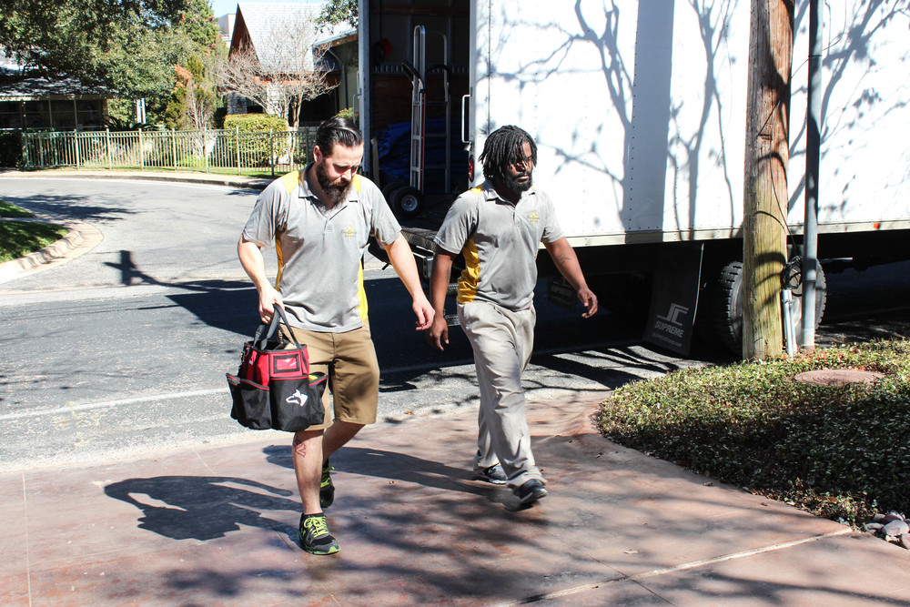 Crew leader Ryan and long time employee Khris headed into a job!