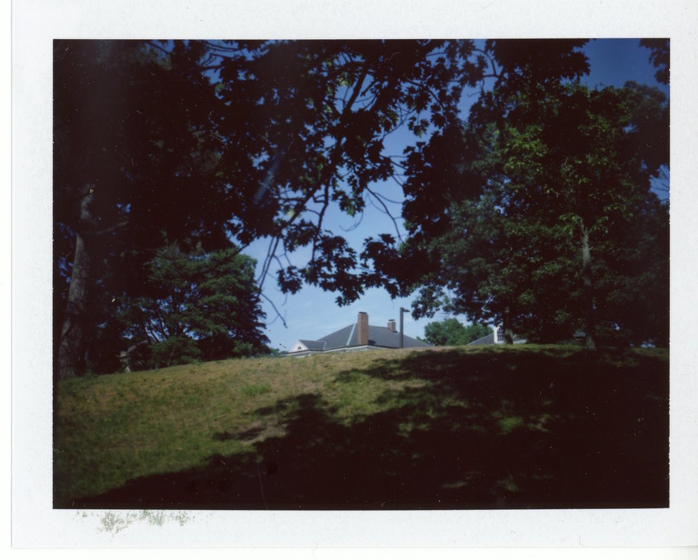 my friend kristie says she feels creepy for looking at this photo. i feel kind of creepy having taken it. it took me four shots to get the house where i wanted it, framed by the hill and the trees.