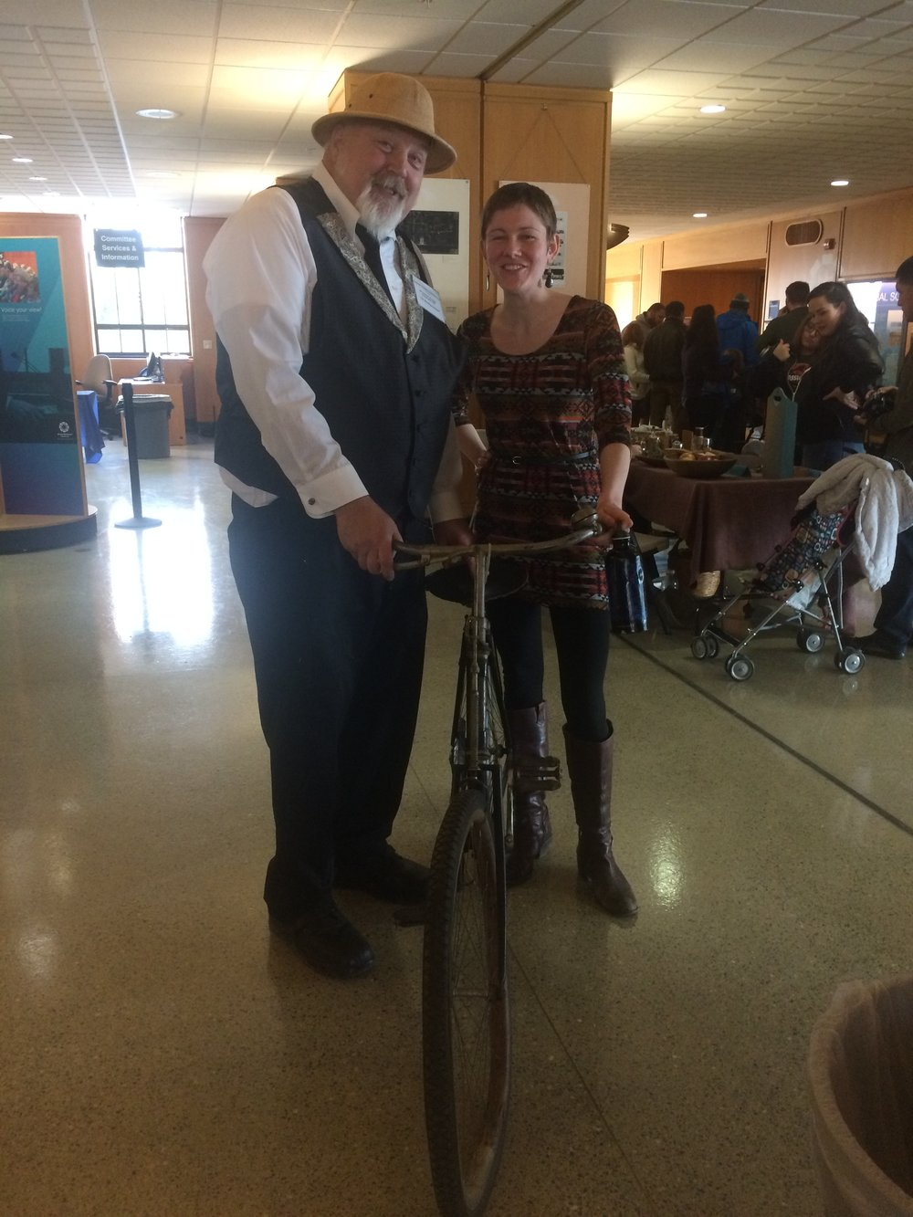 Cayla with Governer T.T. Geer and his beloved bicycle.