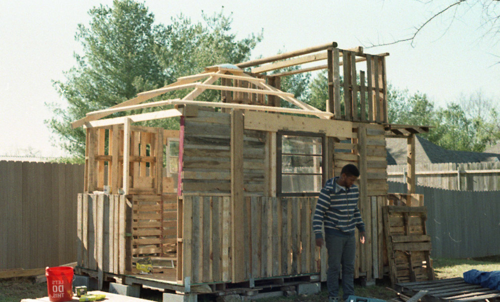 Side view; roof being put together.  Mark in photo.  Taken by Doree.  35 mm, C-41 film.