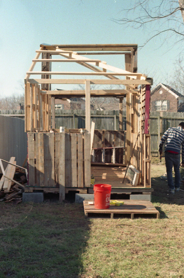 Roof being put together; Mark in photo.  Photo taken by Doree.  35 mm, C-41 film.