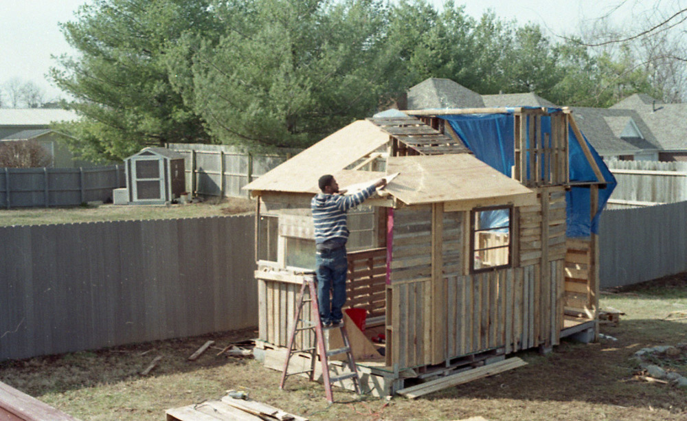 Putting the front roof on.  Photo taken by Doree.  35 mm, C-41 film.