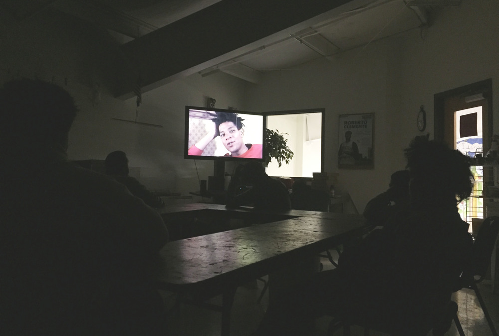 Students watching a film on Jean Michel Basquiat.