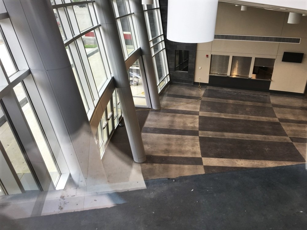 A unique view of the pre-function lobby. Notice the stained concrete pattern.