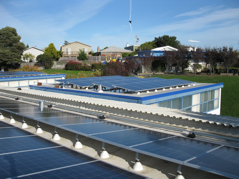 Flat roofs require additional weight to ballast the PV system.