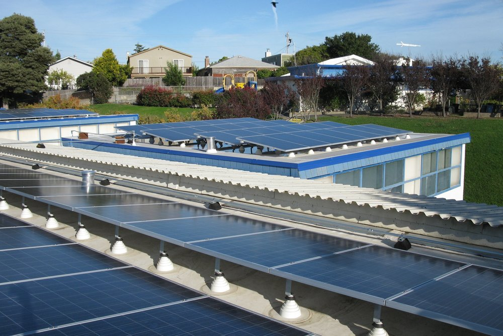Roof-mount PV protects the roof and keeps a building cooler, but can be costly on older or less suitable structures.