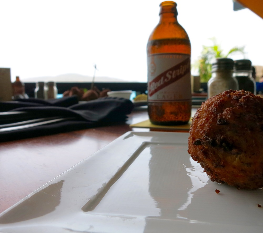 Lunch. Conch Fritters and a Red Stripe