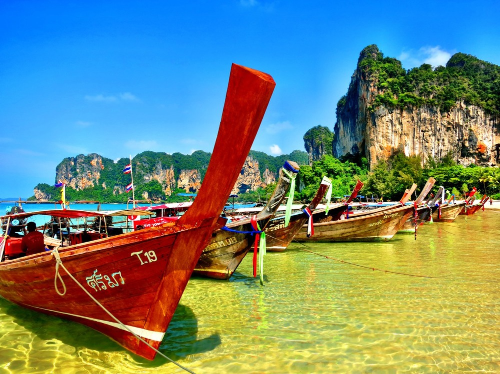 Long boats line up on Railay West beach.