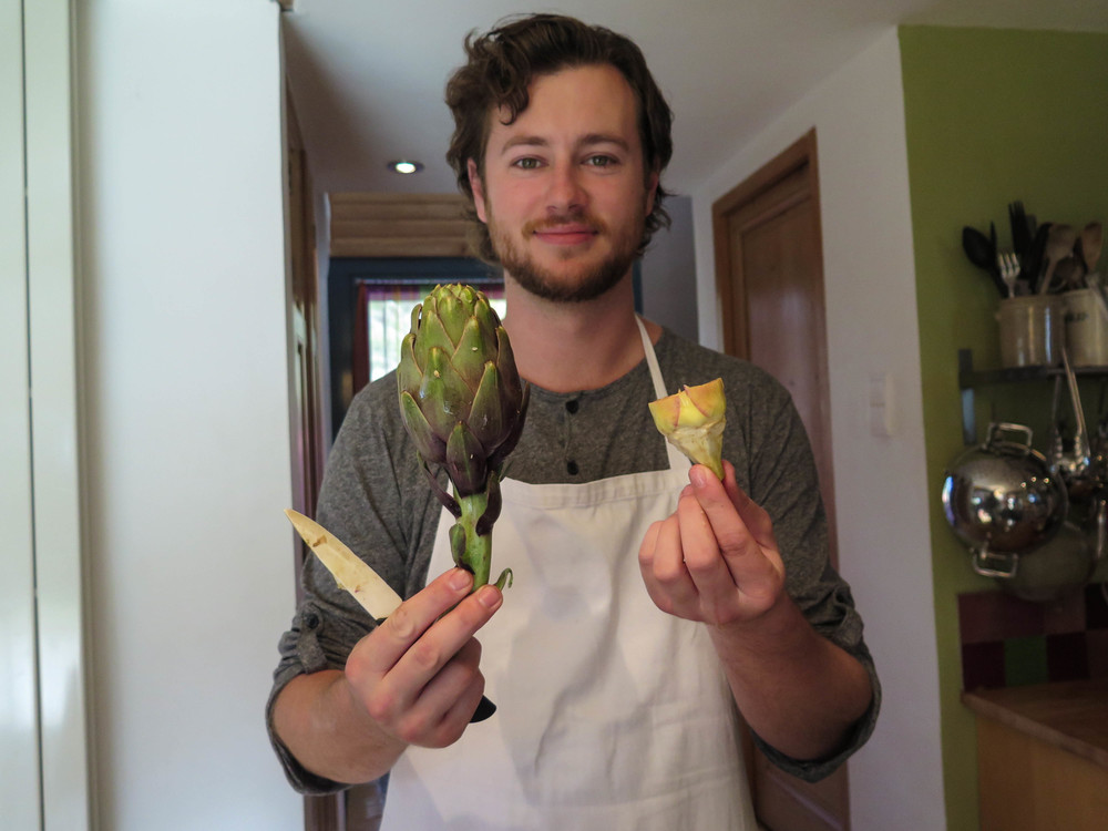 cutting the artichokes