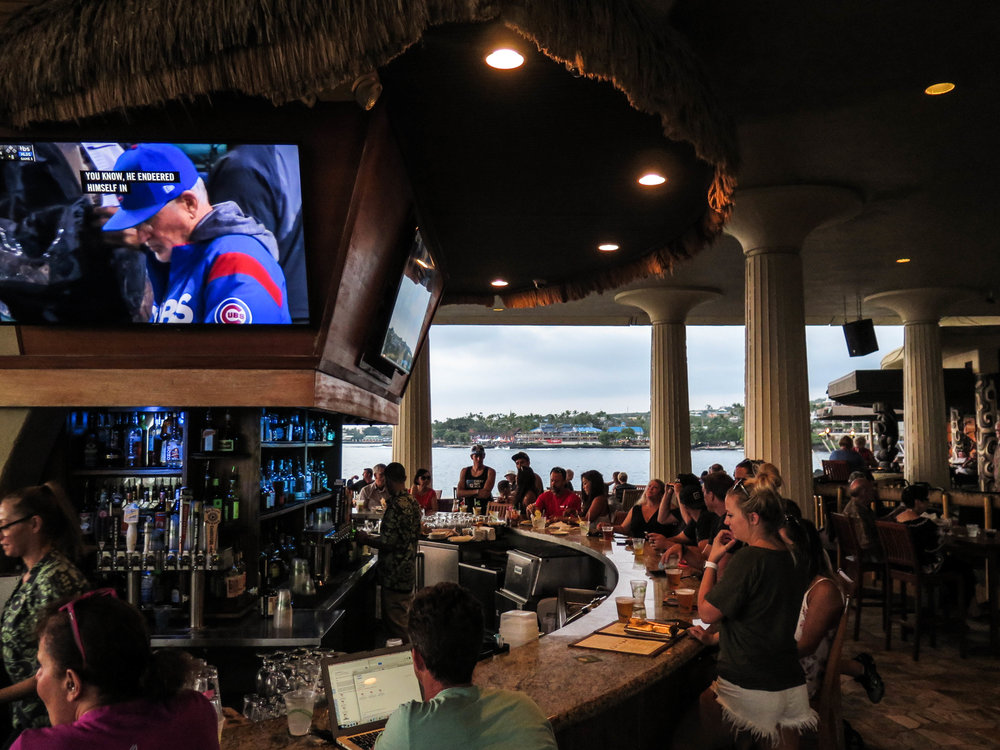 Large HD tvs at the bar with views of the ocean
