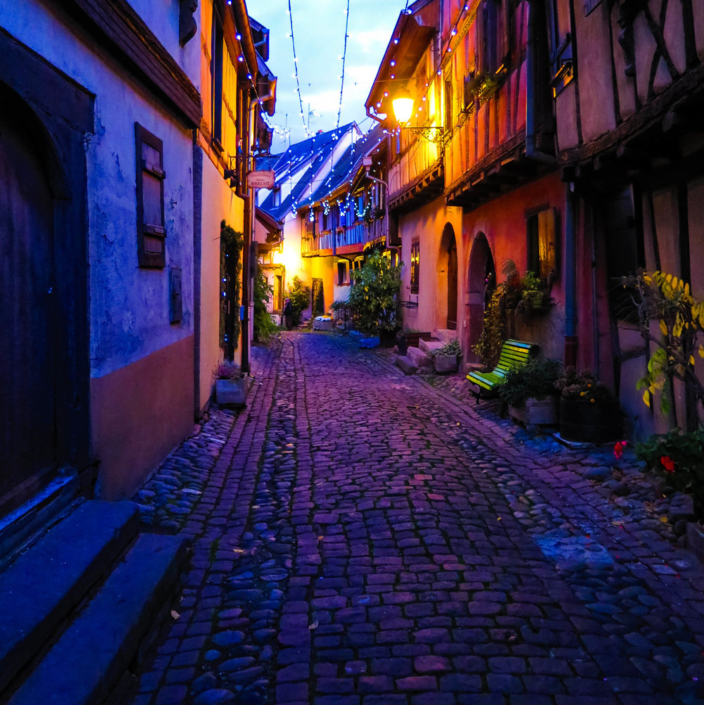 The cobblestone streets of Eguisheim at night.
