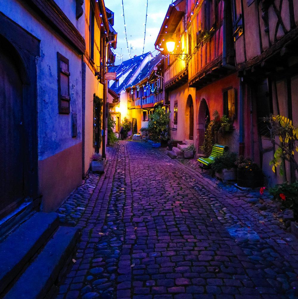 The cobblestone streets of Eguisheim at night.