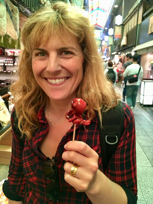 Tiny octopus with an egg yolk stuffed in his head at Nishiki Market
