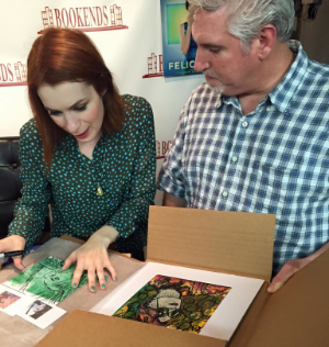 Mike Brennan giving his custom art to actress, comedian and writer, Felicia Day.