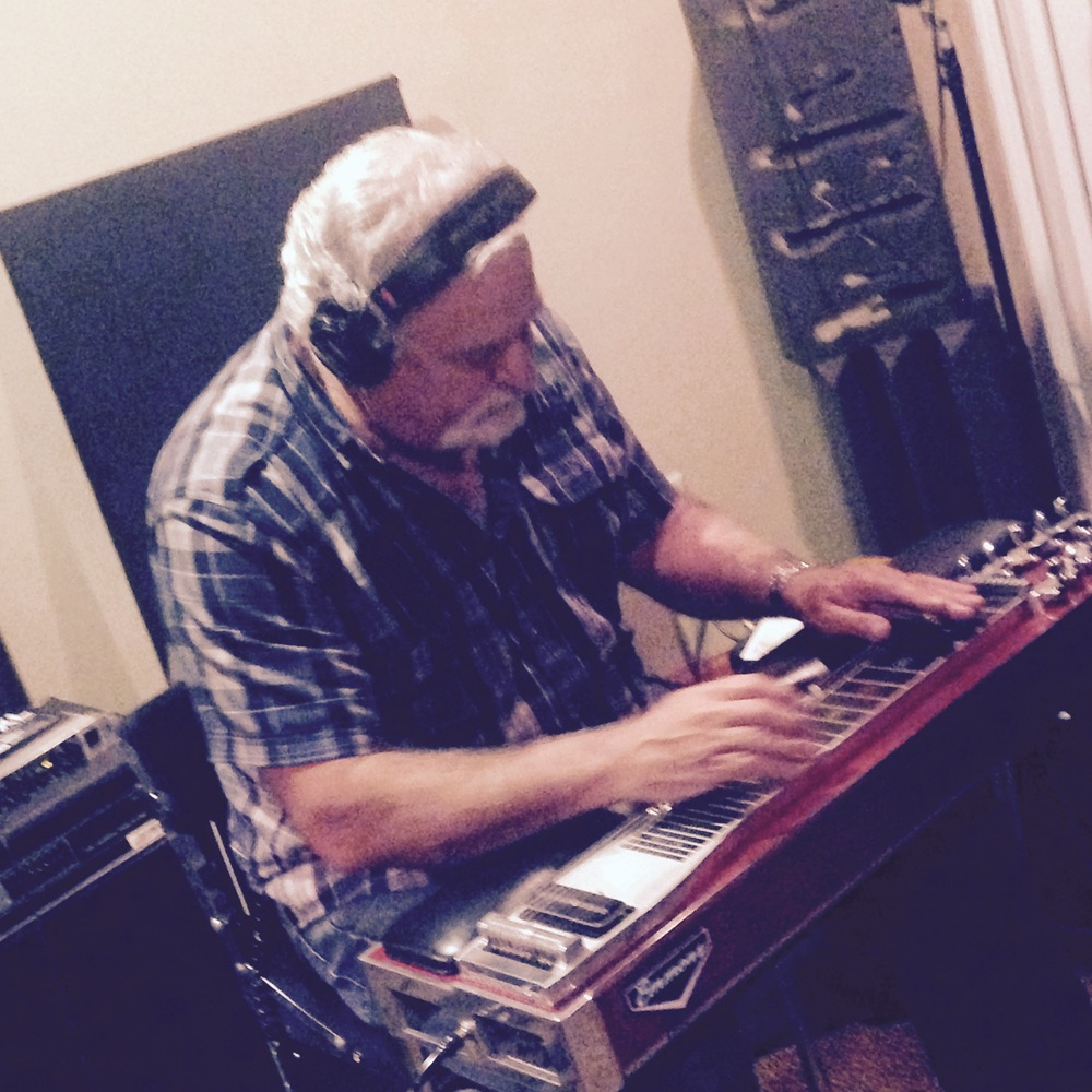 "Tom ""Footy"" Husting on pedal steel."