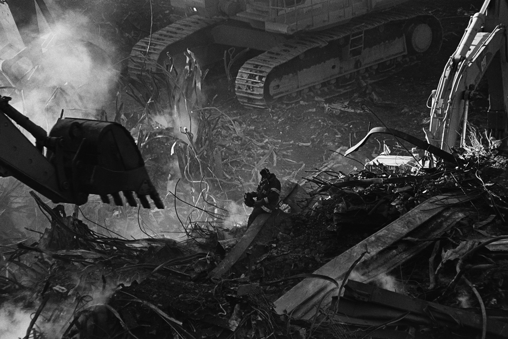 Firefighter in the rubble of Ground Zero  New York, NY.  2001