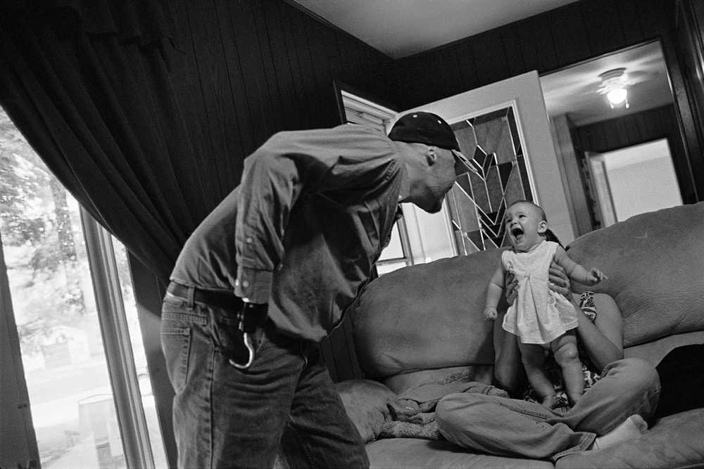 Injured Iraq War veteran Dustin Hill with his daughter and wife  Mineral, IL.  2008