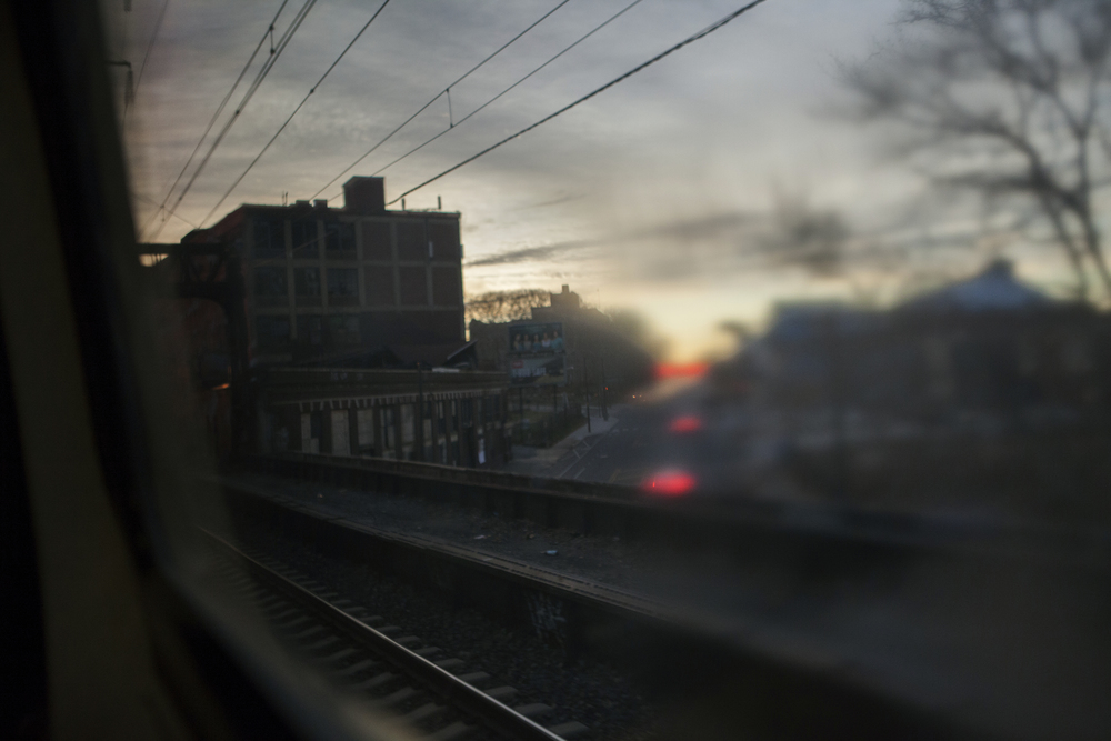 View through the window of an Amtrak train  Metro Park, NJ.  2014