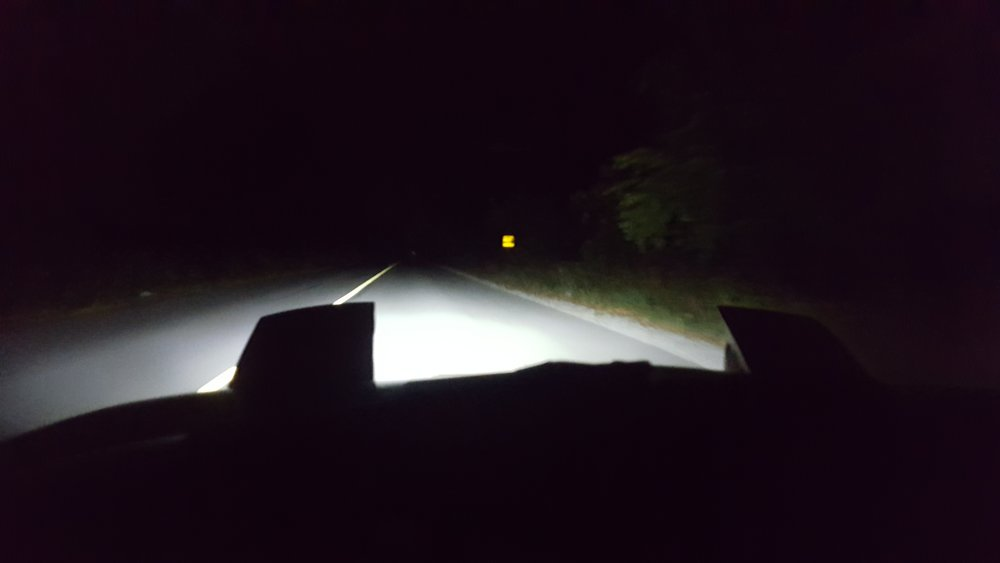 Driving down a road with low beams. (Note how far the light aims after bringing them to a less blinding height.)