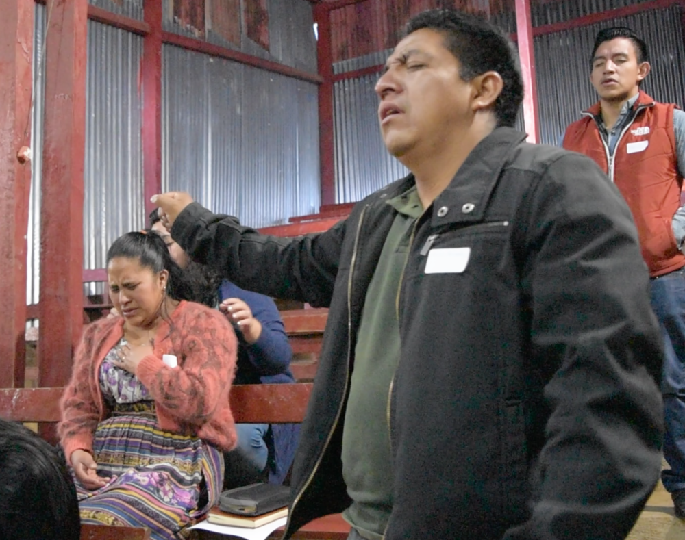 Sandra and Carlos Enrique worshiping Jesus at a Church Mobilization conference.