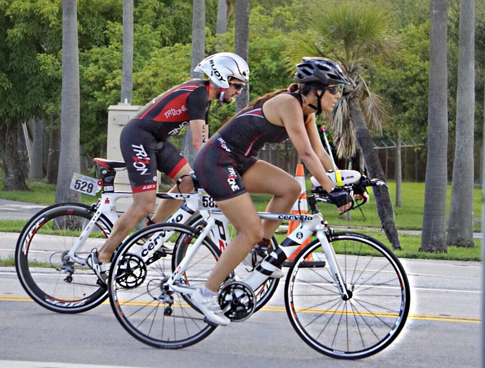 Great shot by Melissa. Here Getting into T2 and caught up with Marjorie. Looks like a Cervelo ad.
