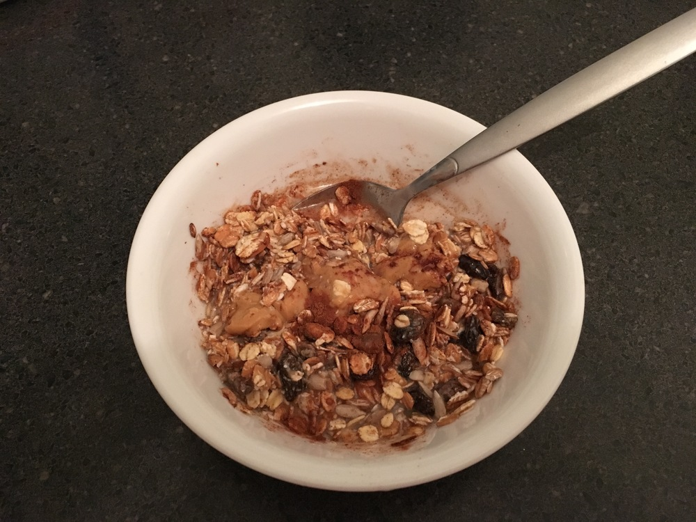 Muesli, almond butter and almond milk down the hatch.