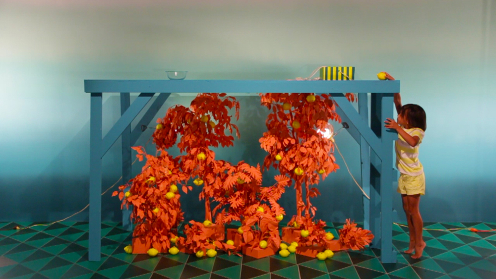 Lemon Drop, Turtle Juice/ Turtle Drop, Lemon Juice, 2014, Wood, candy, juice, fake plants, paint, rope, 10' x 12' x 10'
