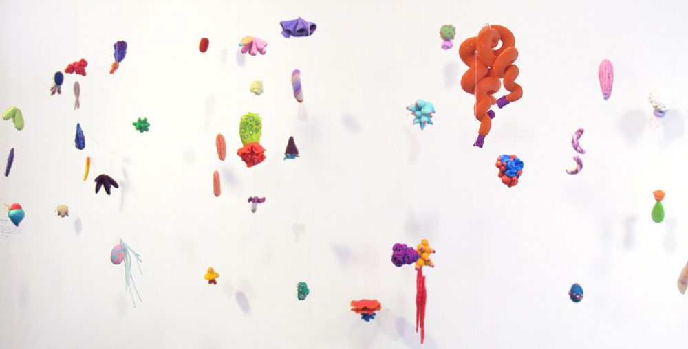 Auroral Confetti, 2014, Polymer clay, found plastics, puffy paint, glass, 9' x 14' x 6'