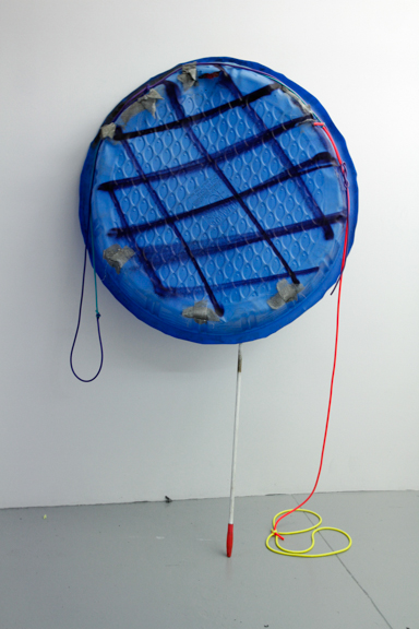 Hanging a round, 2015; Found swimming pool, duster, spray paint and rubber tubing, Variable dimensions
