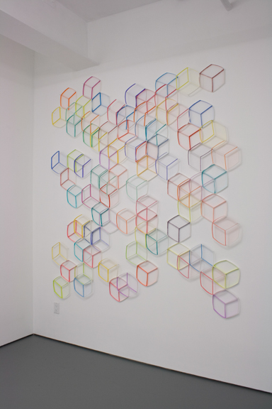 Modular Wall Installation: Hexagon (Cube)  gouache, colored pencil, paper, nails  Dimensions variable  2015  Installed at Tiger Strikes Asteroid New York, 2015 (approx. 7.5 x 6.5 feet)