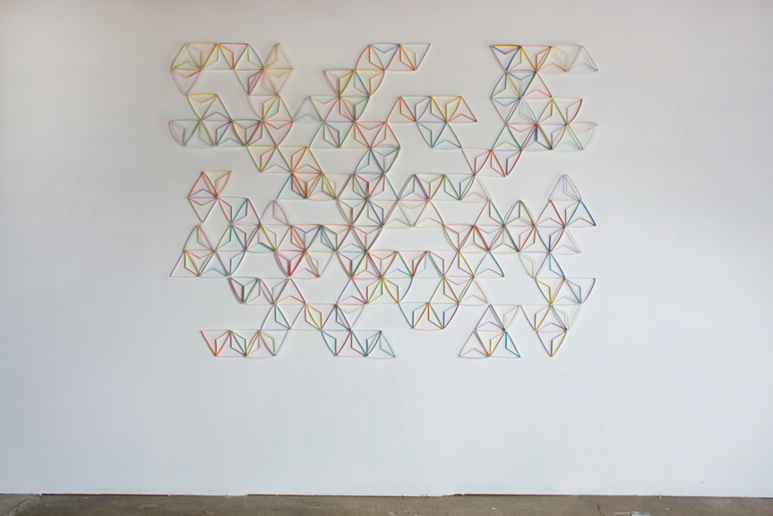 Modular Wall Installation: Equilateral Triangle (Thirds)  gouache, colored pencil, paper, nails  Dimensions variable  2015  Installed at Ball & Socket Art Garage, 2015 (approx. 6.25 x 8.25 feet)