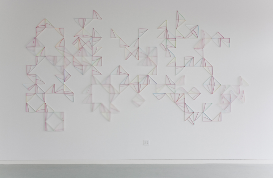 Modular Wall Installation: Right Triangle (Magenta)  gouache, colored pencil, paper, nails  Dimensions variable 2015  Installed at ODETTA, 2015 (approx. 8.25 x 15.75 feet)