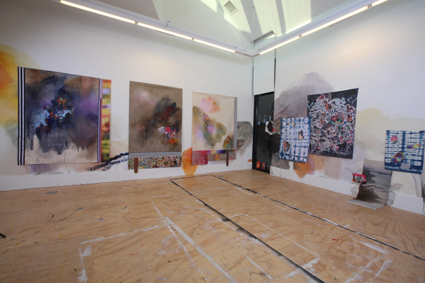 Installation view of studio with wall painting, unstretched paintings, misc. works on fabric, May 2017