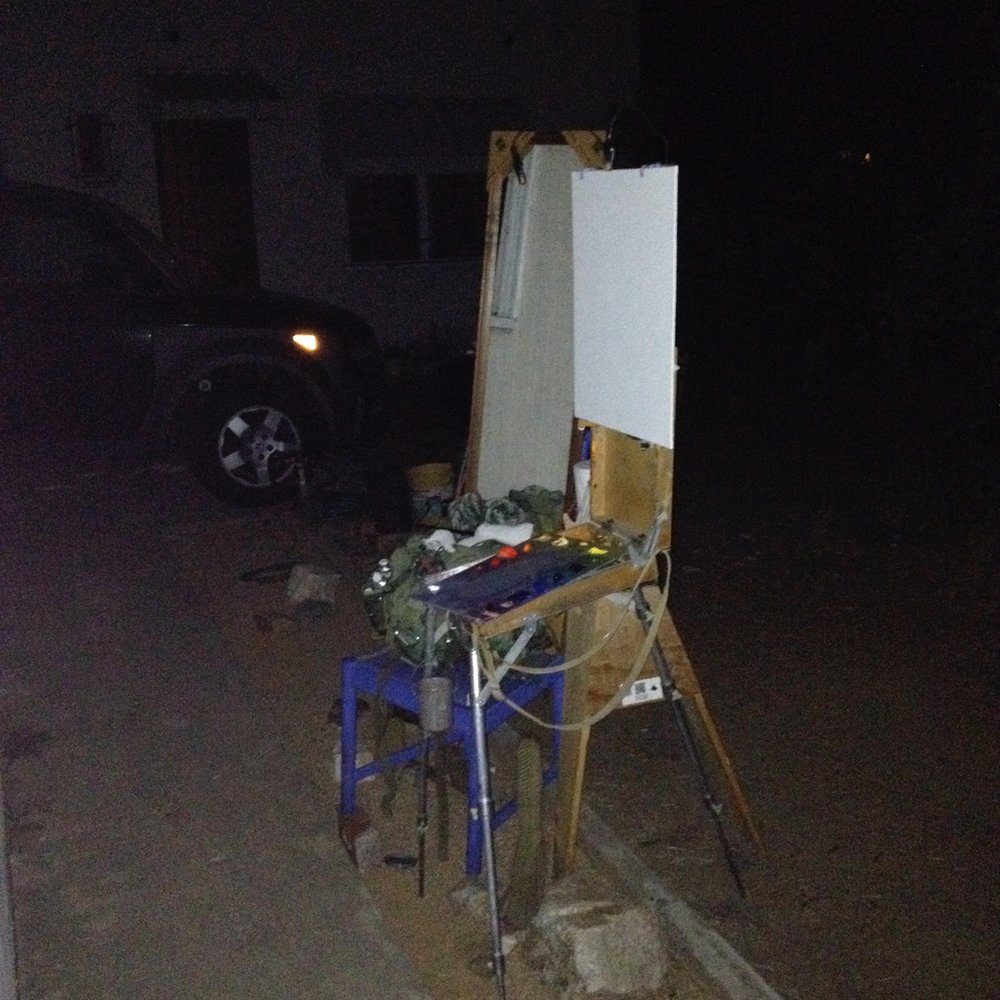 The setup used for painting my Self-Portrait in Moonlight. Mirror sitting on a chair to the left of my easel. I used a full color palette.