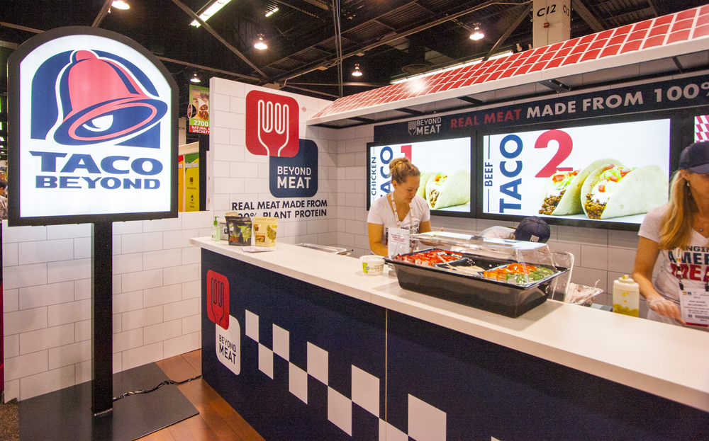 The trade show sample booth was designed to look like a Taco Bell restaurant, complete with signage, uniforms and even those little packs of hot sauce.
