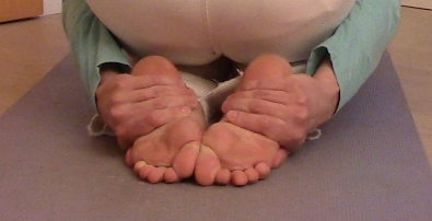 I don't quite reach, but if you can, place your palms directly on your soles.