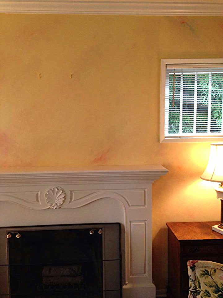 The walls around the fireplace in this Seattle home are a multicolored faux finish to replicate Italian marble.