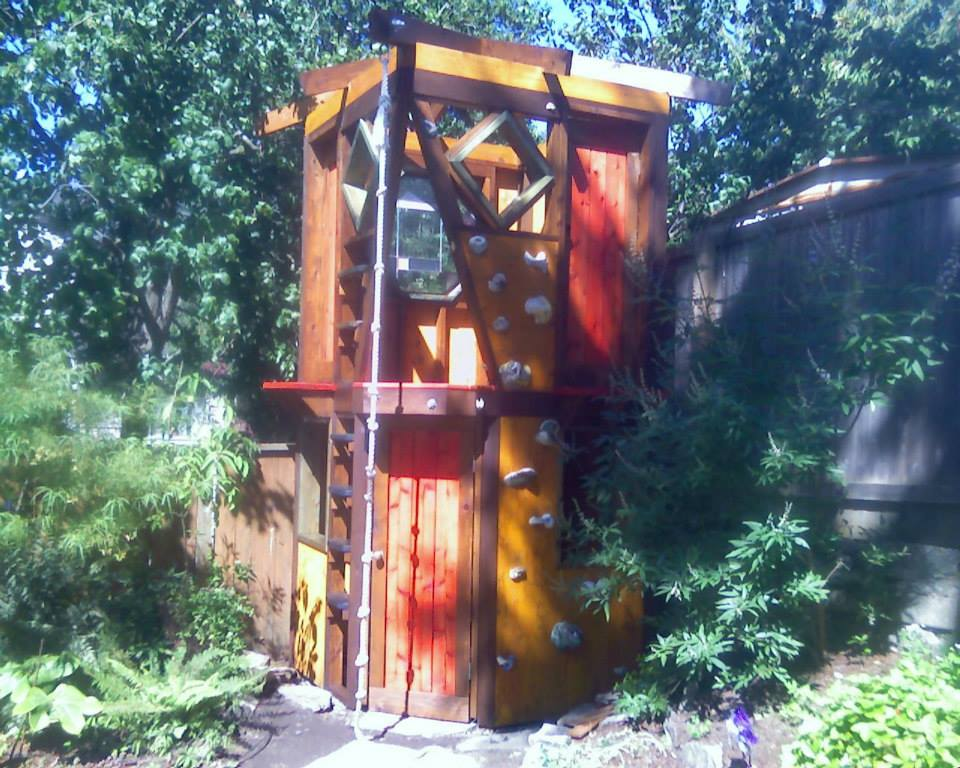 This is a well known musician's playhouse that he himself designed for his children, Elements of Nature constructed and I did the color consultation and staining.