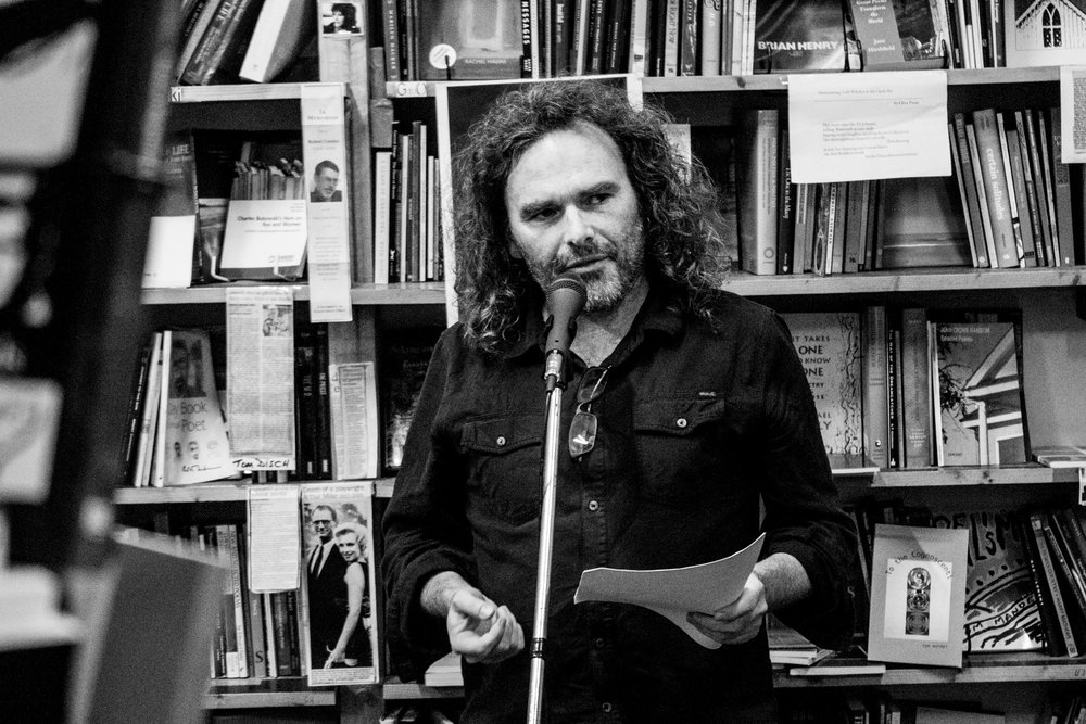 Delivering the judge's report for the 2018 MPU international poetry prize at Collected Works, November 30, 2018. PHOTO BRENDAN BONSACK.