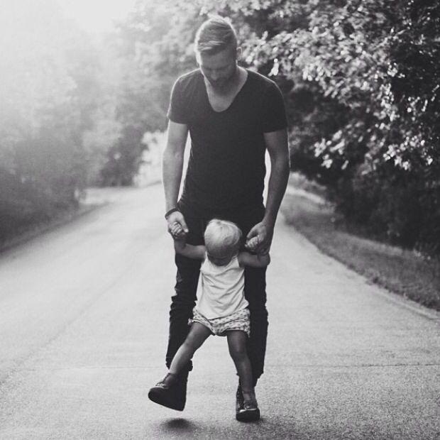Child walking on Dad's feet